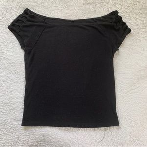 Black top with strappy sleeves